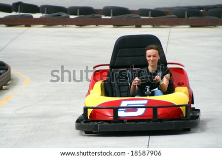 Teenager racing on the Go Cart - stock photo