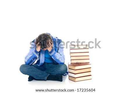 Teenager schoolboy with books on white background - stock photo
