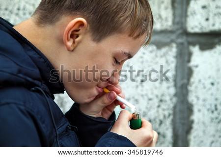 Teenager secretly smoke the Cigarette on the Street - stock photo