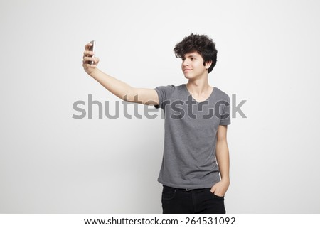 Teenager Shooting a Selfie - stock photo