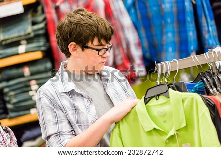 Teenager shopping for new clothes at the department stpre.