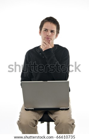 teenager sitting on stool with laptop deep in thought on white background - stock photo
