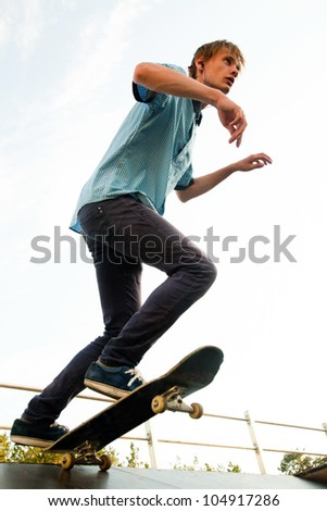 Teenager - skateboarder standing on the start. View from below. - stock photo