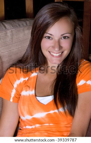 Teenager Smiling - Outside on the Couch - stock photo