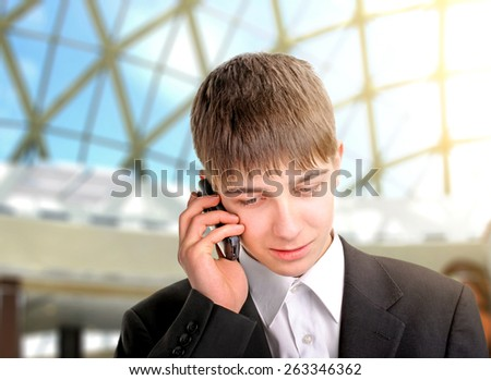 teenager speaking by phone in the big hall - stock photo