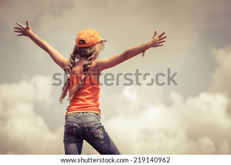 teenager  standing on a mountain top - stock photo