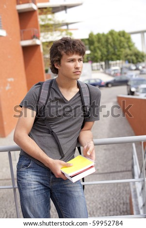 teenager student outside the school looking away - stock photo