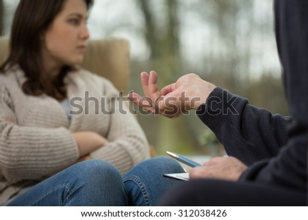 Teenager talking about her problems during therapy - stock photo
