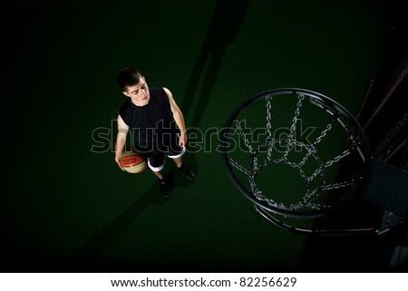 teenager under basket on field isolated - stock photo