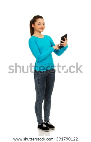 Teenager using a tablet.
