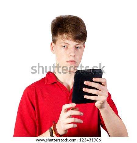 Teenager using ebook reader or tablet pc on a white background - stock photo