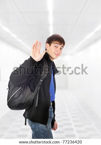 teenager wave goodbye in the white corridor - stock photo