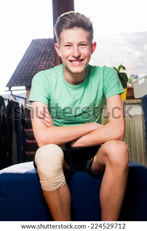Teenager with a bandaged knee.
