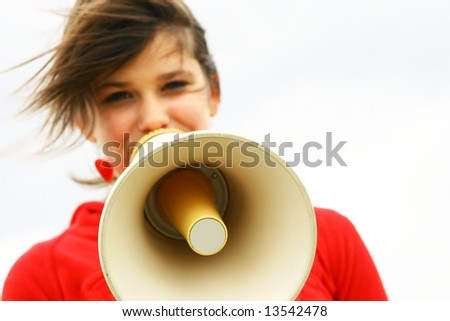 Teenager with a megaphone - stock photo