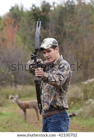 teenager with crossbow - stock photo