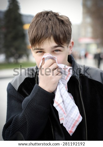Teenager with Handkerchief walk on the City Street