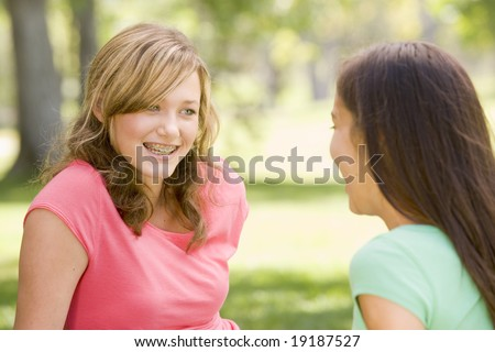 Teenagers Chatting Outside - stock photo