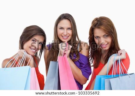 Teenagers coming back from shopping with pride