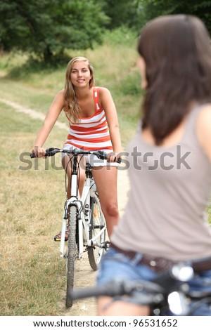 Teenagers cycling - stock photo