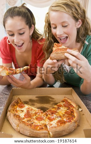 Teenagers Eating Pizza - stock photo