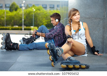 Teenagers hanging out at popular meeting spot for rollers - stock photo