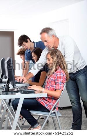 Teenagers in computing class - stock photo