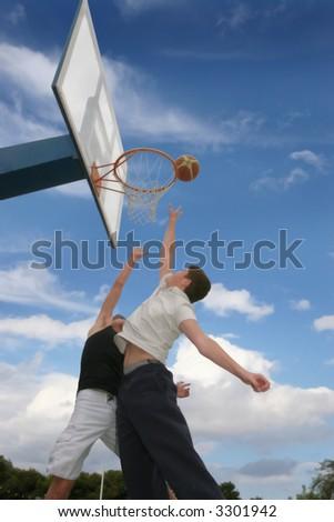 Teenagers play basketball - stock photo