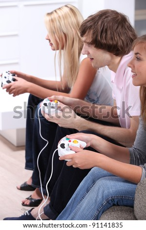 Teenagers playing computer games - stock photo