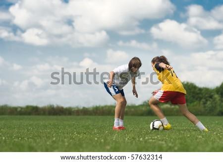 teenagers playing football - stock photo