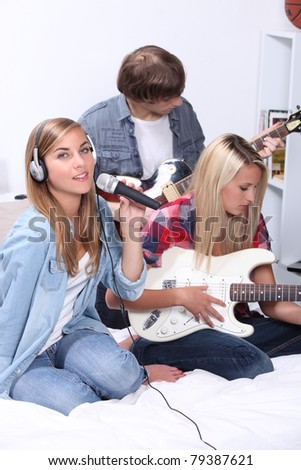 teenagers playing music instruments - stock photo