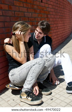 Teenagers Sitting by a street - stock photo
