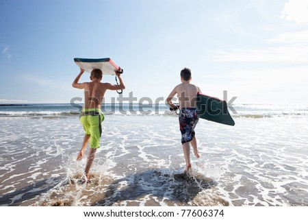 Teenagers surfing