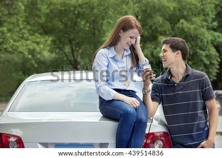 Teenagers with car - stock photo