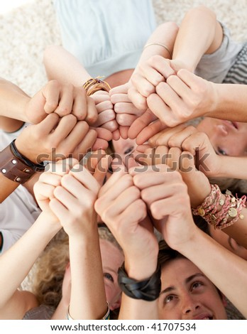 Teenagers with their heads together - stock photo