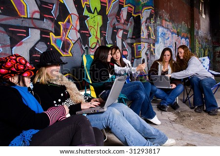 Teenagers working on their laptops with grunge background - stock photo