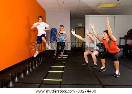 Teenagers working out together in a gym - stock photo