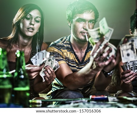 teens at party gambling and doing drugs - stock photo