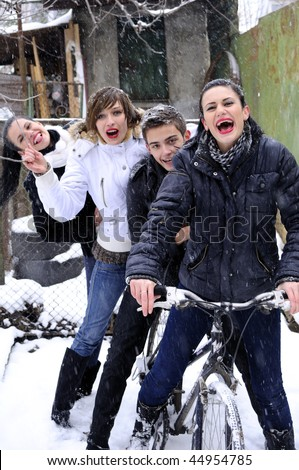 teens having fun with bicycle - stock photo