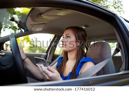 Teens: Lost Teen Female Following Phone Directions - stock photo