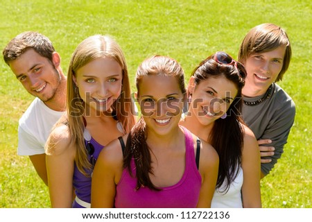 Teens relaxing in the park friends happy leisure young students - stock photo