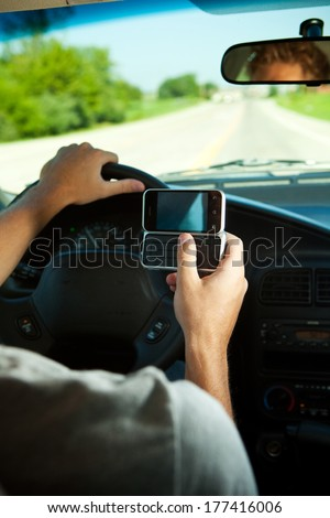 Teens: Teen Male Texting While Driving