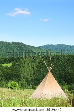 teepee in the Carpathian Mountains - stock photo