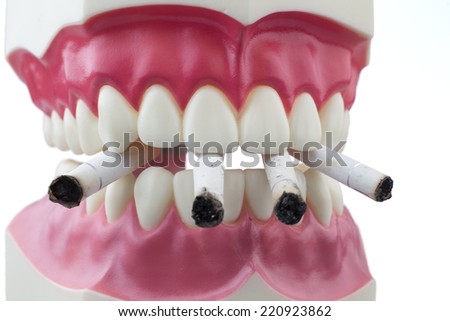 Teeth and a cigarettes with white background