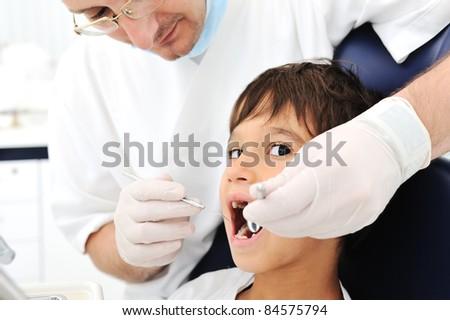 Teeth checkup at dentist's office - stock photo