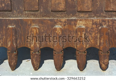 Teeth of Excavator Bucket as Construction Machinery - stock photo