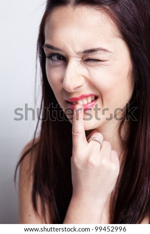 Teeth problems concept - woman touching her mouth - stock photo