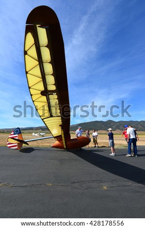 TEHACHAPI, CA - MAY 28, 2016: A group of interested admirers congregate around of a Bowlus BA-100 Baby Albatross glider prior to takeoff at Mountain Valley Airport.
