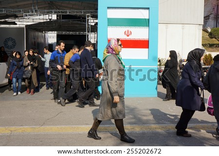 TEHRAN, IRAN - FEB 11 2015: Iran, Tehran, Meydan Azadi (Azadi Square), February 11 2015. Iranian people during celebrate 36th Anniversary of Islamic revolution.