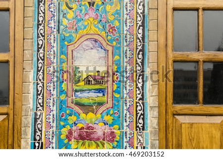 TEHRAN, IRAN - FEBRUARY 29, 2016: Renovated old Mosaic wall & window in Golestan palace museum. The Golestan Palace is the former royal Qajar complex, inscribed on the UNESCO World Heritage List.