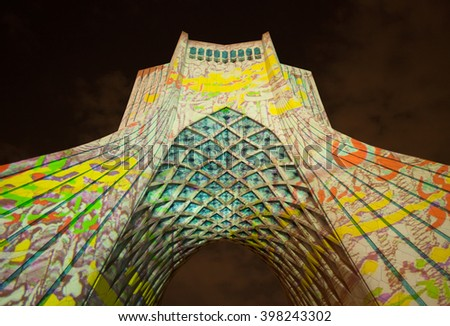 TEHRAN, IRAN - OCTOBER 4, 2015: Light Concert entitled Gate of Words projected on Azadi Monument. The Light Show was designed by Philipp Geist exclusively for this landmark of Tehran. - stock photo
